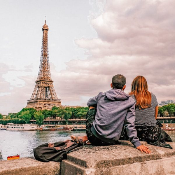 A couple enjoying the view of the Eiffel Tower, one of the best things to see on a romantic weekend in Paris