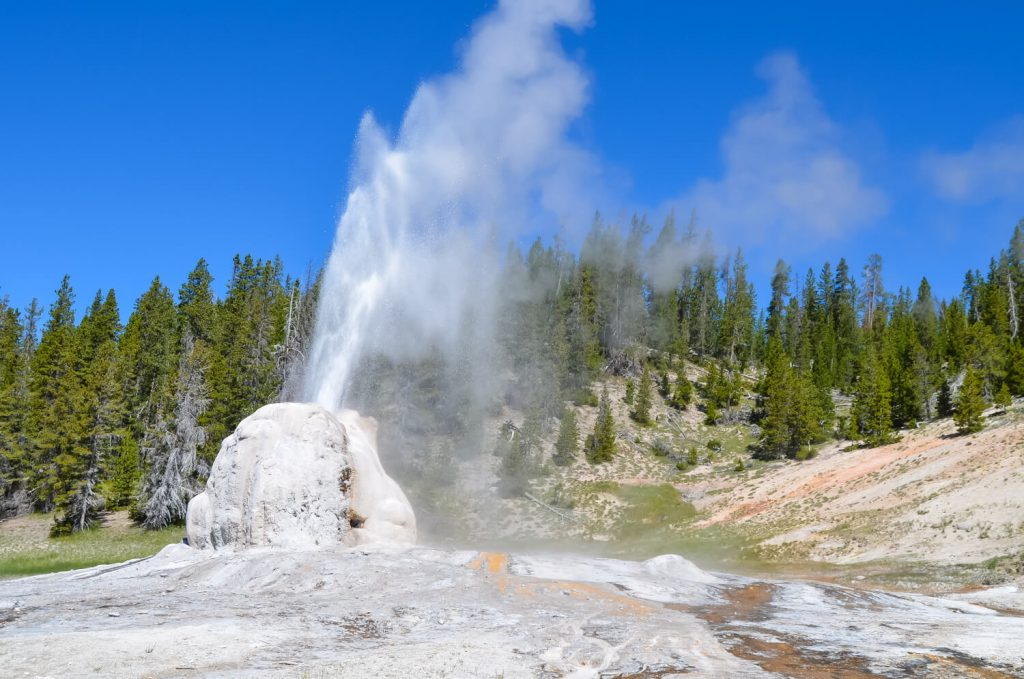 An erupting geyser at Yellowstone National Park, a place on everyone's USA outdoor bucket list