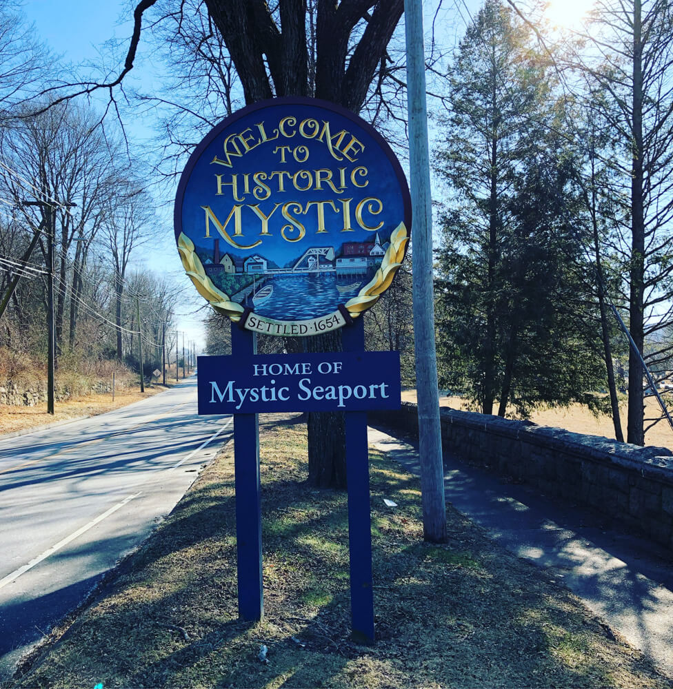 Welcome sign for the charming US town of Mystic Connecticut